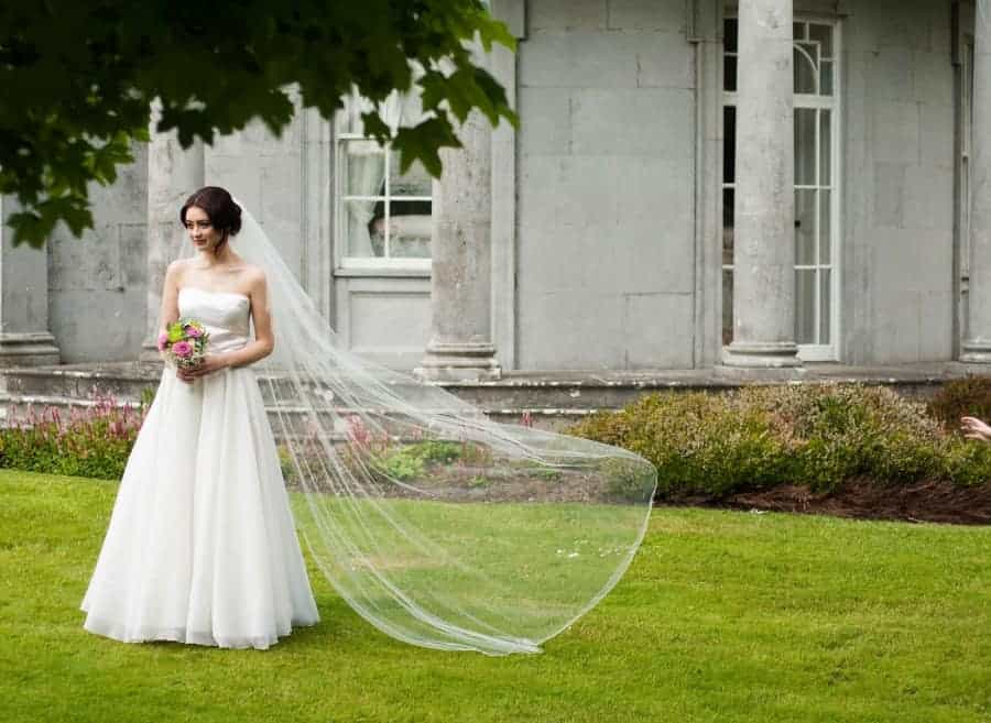 Bride wearing a 1 tier chapel length veil with corded edge and made from illusions bridal tulle
