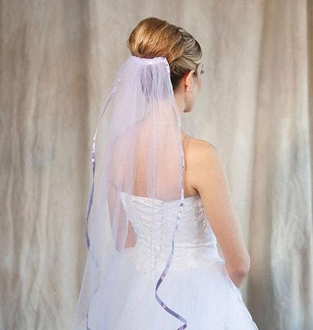 Bride wearing 1 tier Victorian lilac colored fingertip veil with ribbon edge