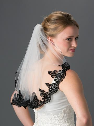 bride_wearing_veil_with_black_lace_edge_large