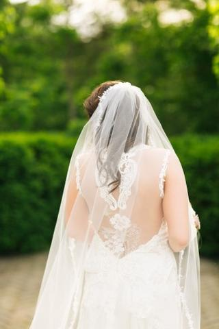 bride wearing a mantilla style chapel length bridal veil