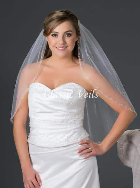 Bride Weaering Waist Length Veil With Hair Half Up Half Down