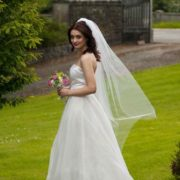 bride-wearing-a-1-tier-bridal-illusion-tulle-floor-length-veil