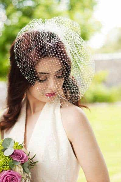 bride in vintage style birdcage veil with french netting