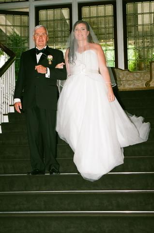 bride-and-father-walk-down-stairs