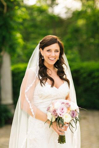 Bride wearing a 1 tier chapel length custom made bridal veil with lace edge