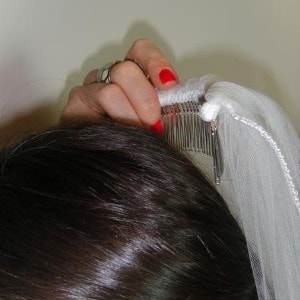 Rotate The Comb Backwards So Concave Part Of Is Now Facing Downwards Then Push Into Your Hair